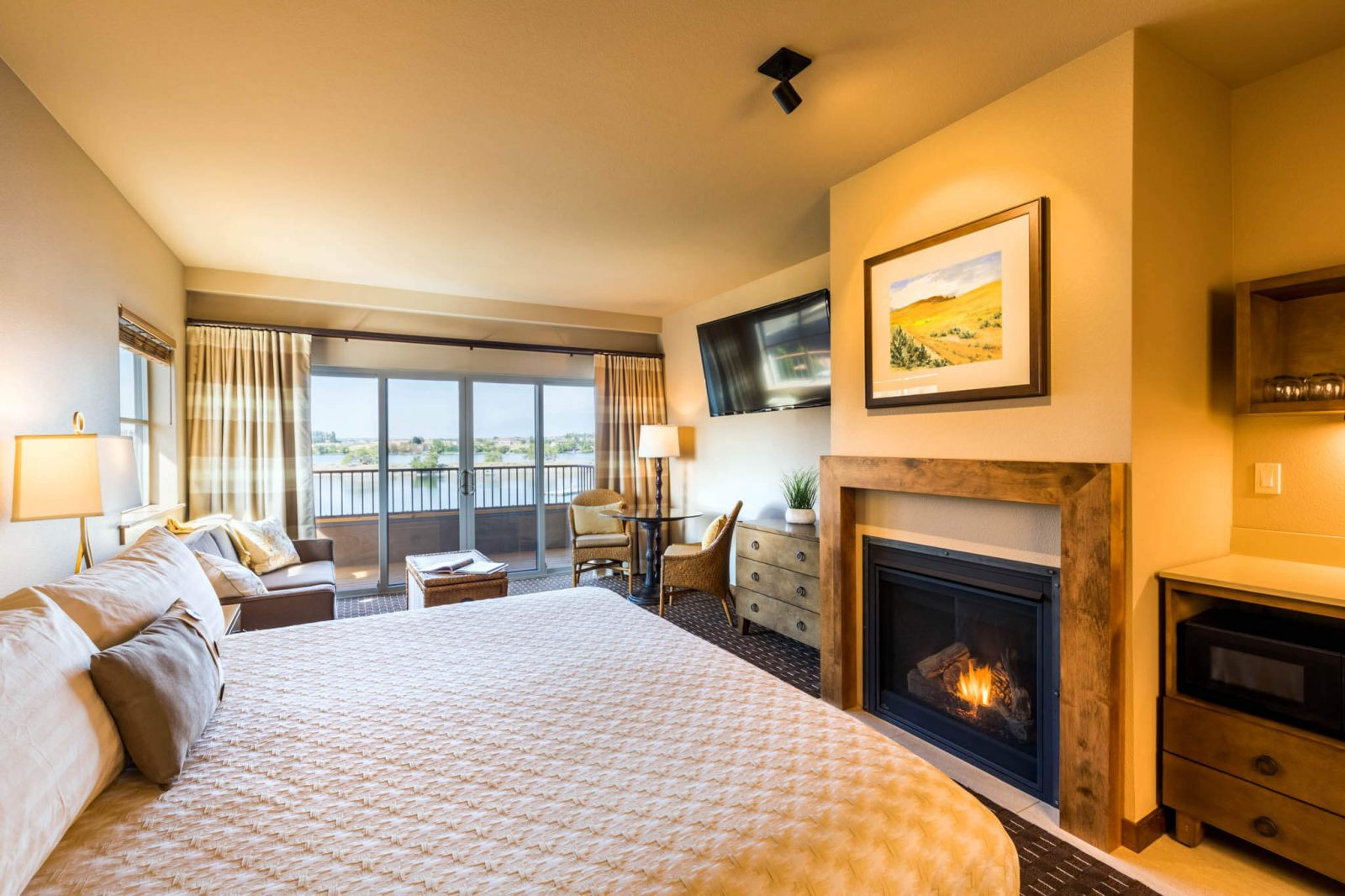 Beautiful room with a cozy fireplace and riverfront view
