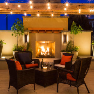 Sit poolside around a fire at our hotel