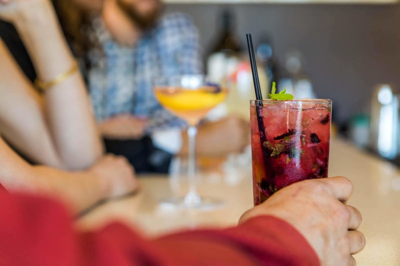 Grab some drinks with your friends at the Vine Wine and Craft Bar