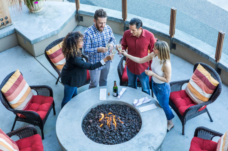 Cheers to the weekend, friends around our firepit