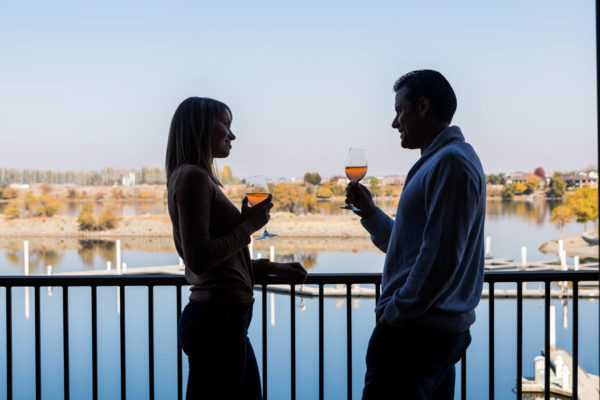 Take time to sip some wine on the riverfront