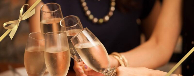 Champagne flutes filled to cheers