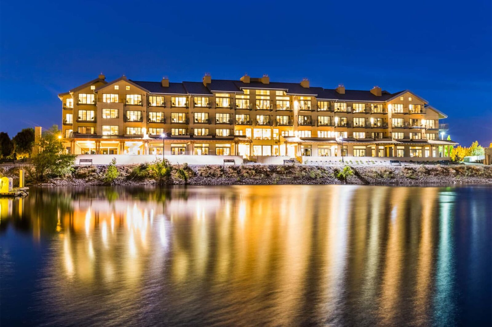 Night shot of The Lodge on the river