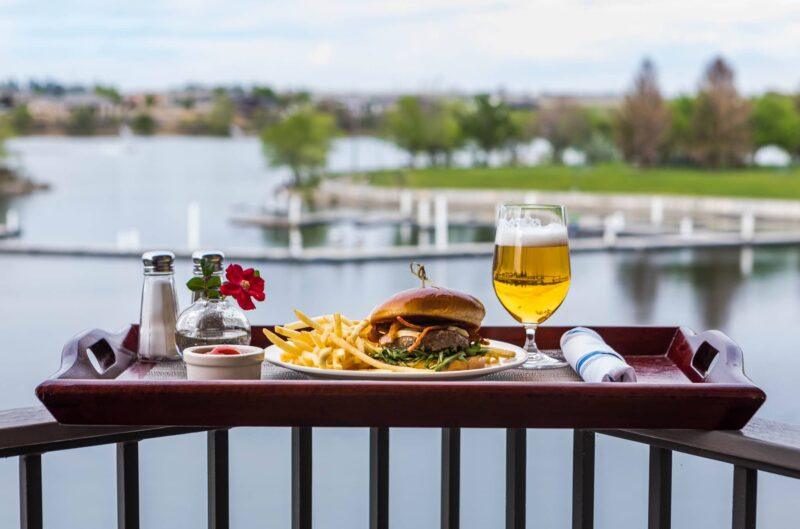 Enjoy a burger on your private balcony overlooking the Columbia River